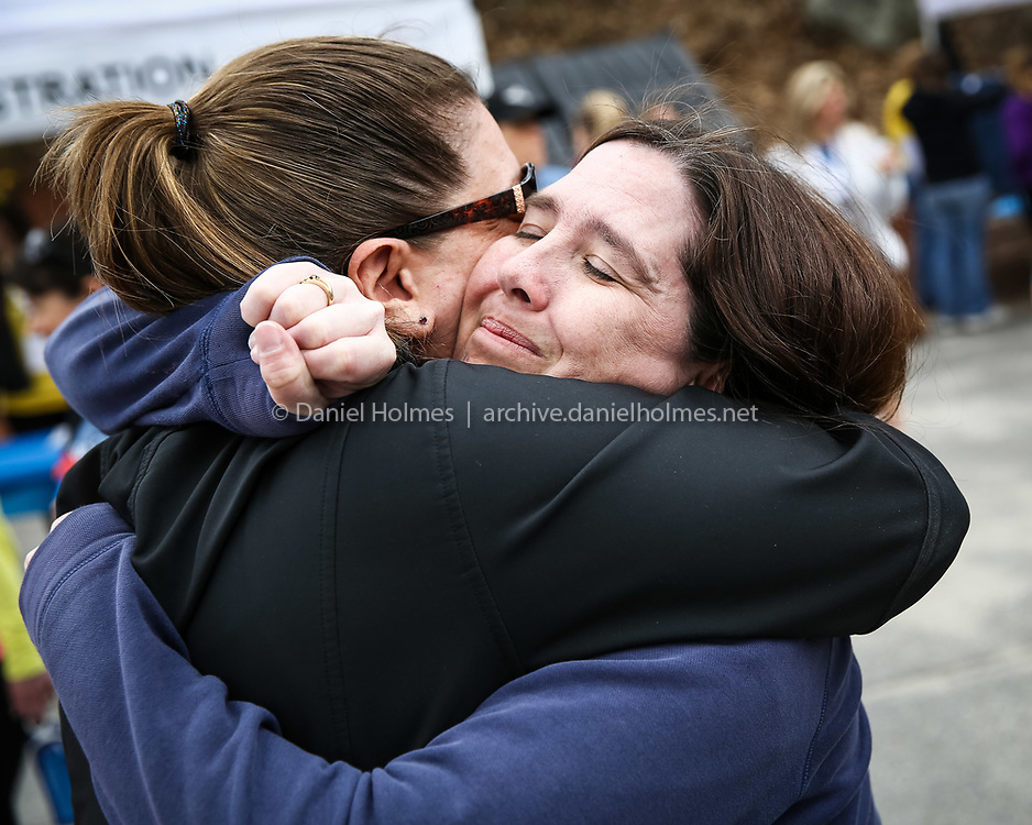 (5/4/14, MARLBOROUGH, MA) Shannon Adams, aunt of Trisha Bennett, hugs a friend during the 2nd annual Trisha Bennett memorial 5K road race at the Moose Lodge in Marlborough on Sunday. Bennett was one of two people stabbed to death inside a Hudson apartment in 2010. The race was held to raise money and awareness about domestic violence. Daily News and Wicked Local Photo/Dan Holmes