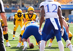 Oct 6, 2018; Morgantown, WV, USA; West Virginia Mountaineers quarterback Will Grier (7) takes the snap under center during the second quarter against the Kansas Jayhawks at Mountaineer Field at Milan Puskar Stadium. Mandatory Credit: Ben Queen-USA TODAY Sports