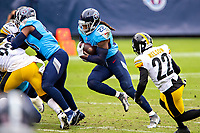 NASHVILLE, TN - OCTOBER 25:  Derrick Henry #22 of the Tennessee Titans runs the ball in the second half of a game against the Pittsburgh Steelers at Nissan Stadium on October 25, 2020 in Nashville, Tennessee.  The Steelers defeated the Titans 27-24.  (Photo by Wesley Hitt/Getty Images) *** Local Caption *** Derrick Henry