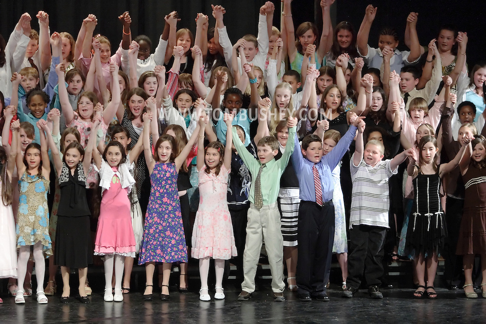 Newburgh, NY - Members of the All-County Chorus raise their arms after performing at the Elementary All-County Music Festival at Newburgh Free Academy on April 28, 2007..