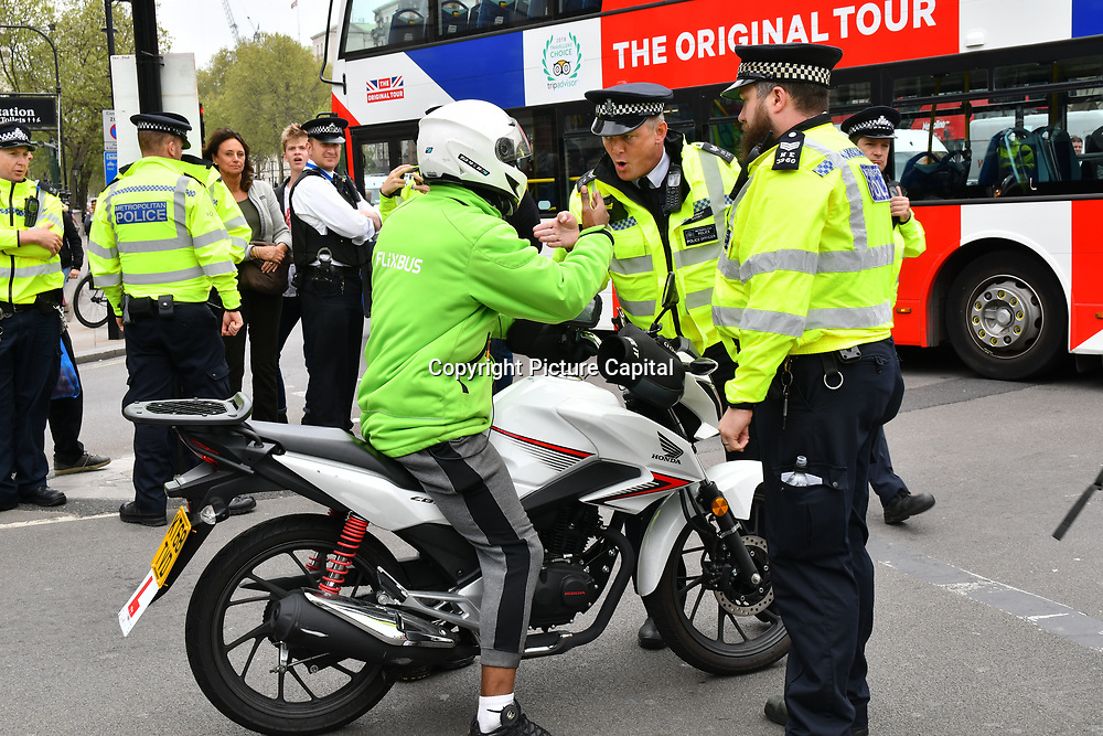Hundreds climate change protestors continue and block road on Day 9 with heavy police present - Extinction Rebellion, at Parliament Square, on 24 April 2019, London, UK