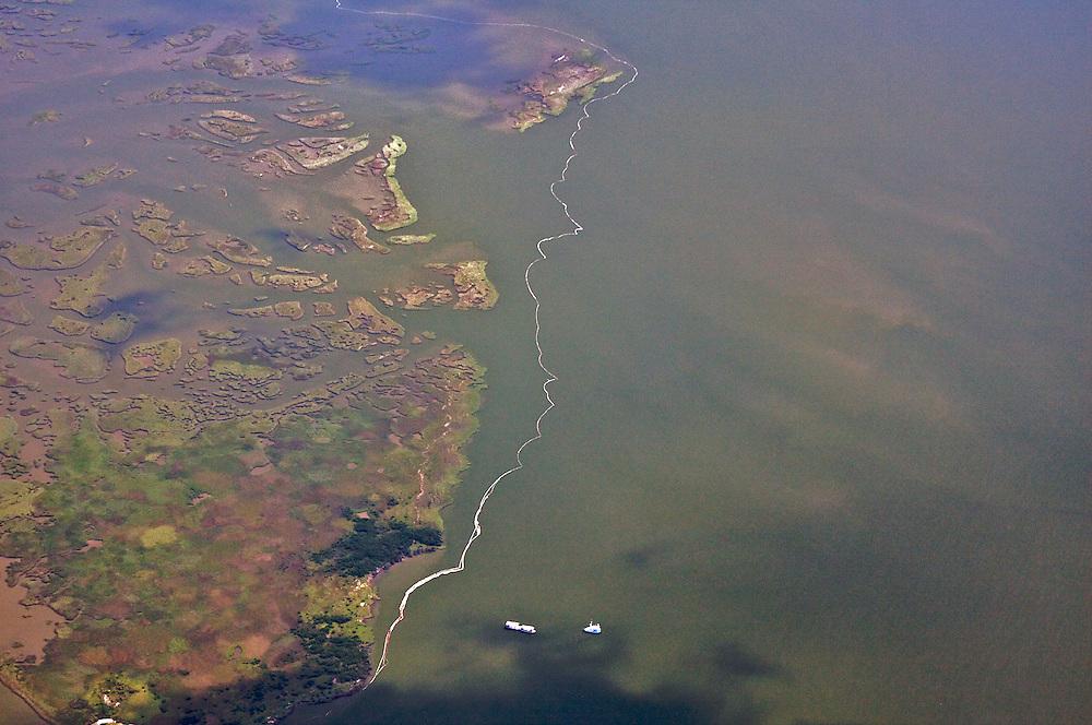 Oil boom protecting shoreline, Plaquemines Parish, Louisiana, USA