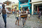"""In the immediate aftermath of the flight into French exile of the Haitian president """"Baby Doc"""" Duvalier, residents in the city of Port-au-Prince go on city wide rampage and looting. The army attempt to intervene with little success such was the hate for the regime. Haiti."""