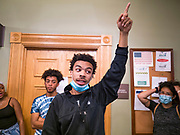 12 JUNE 2020 - DES MOINES, IOWA: MATTHEW BRUCE, a member of Black Lives Matter, leads a protest in the Iowa State Capitol. About 75 activists from Black Lives Matter came to the Iowa State Capitol in Des Moines Friday to talk to Iowa Governor Kim Reynolds. They've been trying to meet with Gov. Reynolds all week. She made time for them Friday and met with 5 representatives of the organization without any media in the room. They wanted to talk to her about police violence against African-Americans and racial disparities in Iowa's justice system. While the 5 met with the Governor, the remaining activists picketed the hall in front of her office and chanted.     PHOTO BY JACK KURTZ