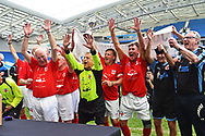 The England over 60's with Tommy Charlton of England celebrate their victory with the Just International Cup during the trophy presentation which they won 3-0 during the world's first Walking Football International match between England and Italy at the American Express Community Stadium, Brighton and Hove, England on 13 May 2018. Picture by Graham Hunt.