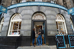 Edinburgh, Scotland, UK. 4 June 2020.  As Covid-19 lockdown relaxation continues in Scotland very few shops and businesses are open. Streets remain quiet and pubs and, with a few exceptions, bars and pubs are closed. Pictured; Topping & Company bBooksellers is offering a takeaway book service from the front door . Iain Masterton/Alamy Live News