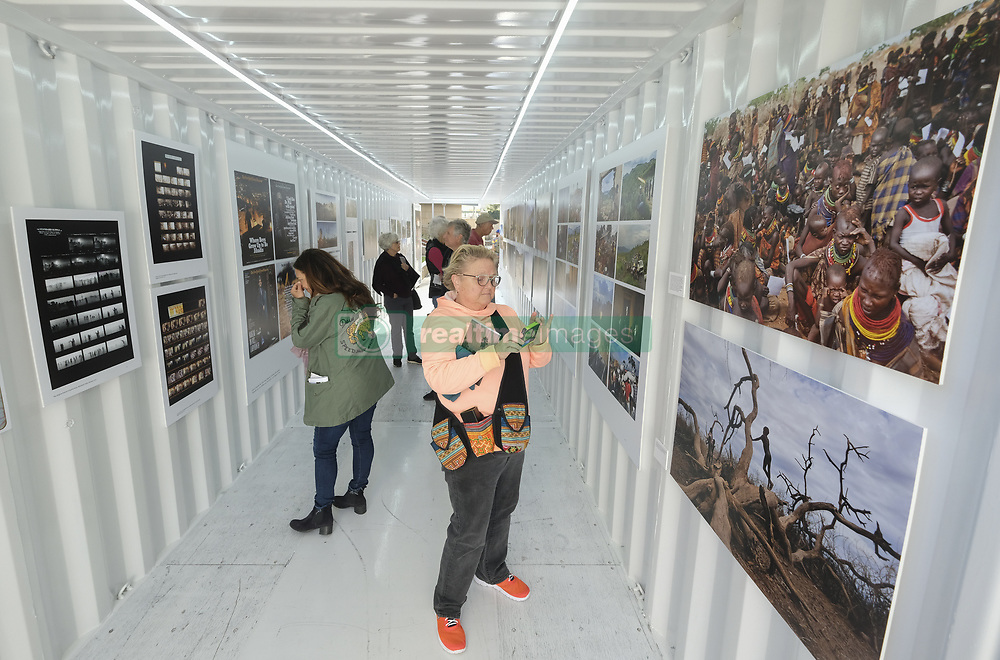 May 3, 2019 - Los Angeles, California, U.S - Attendees view the exhibitions during Photoville 2019 at the Annenberg Space for Photography in Los Angeles, the United States on May 3, 2019.Photoville began as a free outdoor photo festival near the Brooklyn Bridge in New York seven years ago with a modular venue constructed from shipping containers. This is the first time a Photoville event is being held in Los Angeles. (Credit Image: © Ringo Chiu/ZUMA Wire)