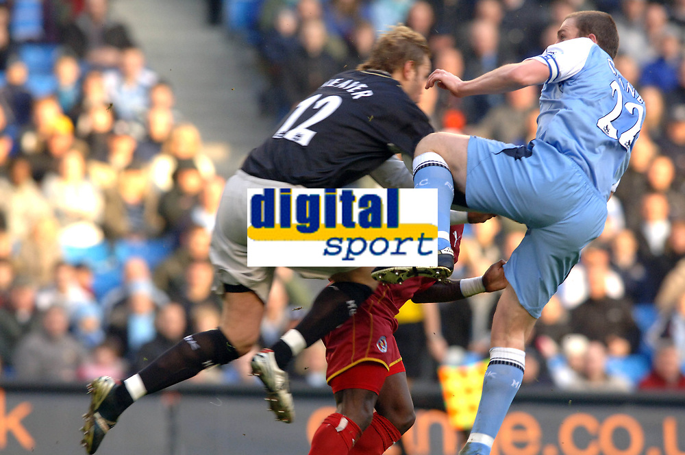 Photo: Paul Greenwood.<br />Man City v Reading. The Barclays Premiership. 03/02/2007. Man City keeper Nicky Weaver, left, collides with his defender Richard Dunne, right, as Reading's Leroy Lita is sandwiched in the middle