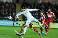 Swansea city's Luke Moore heads the ball. Capital one cup, quarter final, Swansea city v Middlesbrough at the Liberty Stadium in Swansea, South Wales on Wednesday 12th Dec 2012. pic by Andrew Orchard, Andrew Orchard sports photography,