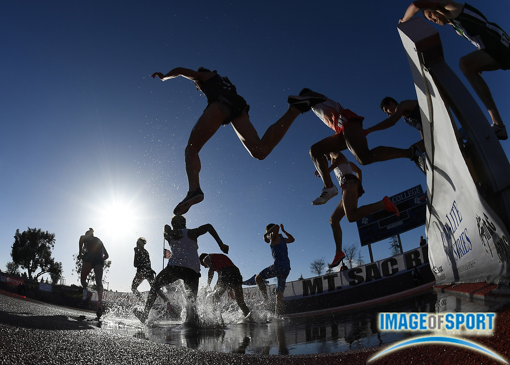 Apr 19, 2018; Torrance, CA, USA; Runners race over the water jump in the steeplechase during the 60th Mt. San Antonio College Relays] at Murdock Stadium.