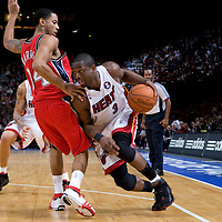 9 October 2008: Dwyane Wade of the Miami Heat dribbles past Devin Harris of the New Jersey Nets during the New Jersey Nets 100-98 overtime victory over the Miami Heat in an exhibition game at Bercy Arena, in Paris, France.