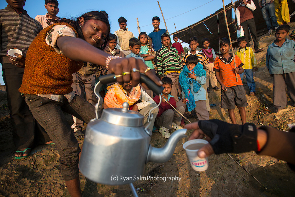 Local chaiwhallah (tea man) fills us up riverside with an early morning jolt on the Ganga.
