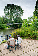 Maidenhead, Berks, 29th June 2021, Older Couple sit and  Draw/paint, Taplow Bridge, crossing the River Thames in the Thames Valley, © Pete Spurrier