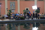 TV production crew filming programme on location, city of Valencia, Spain