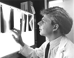 Male doctor examining patient's Xrays,