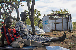 Food rations have currently been cut due to shortages. More than 300,000 South Sudanese refugees have fled from the country's civil war into Uganda since fighting broke out in July. They mostly travel by foot for days through the bush as roads have been blocked or are too dangerous to cross. The massive influx of refugees has caused a strain in humanitarian aid due to large numbers and lack of funding. BidiBidi settlement is now the third largest in the world and holds more than 210,000 people since its opening in September.