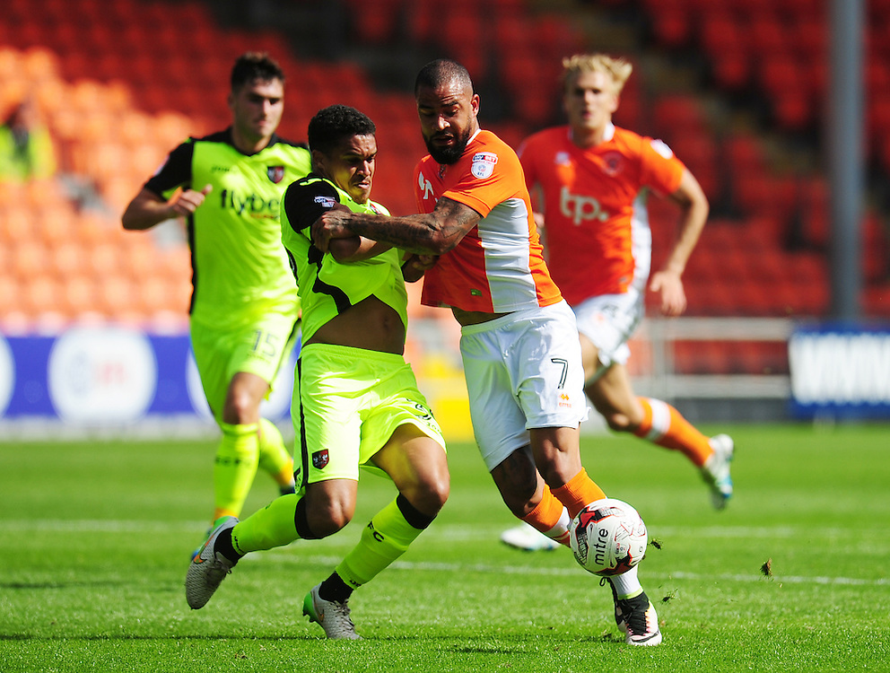 Blackpool's Kyle Vassell is fouled by Exeter City's Troy Brown<br /> <br /> Photographer Kevin Barnes/CameraSport<br /> <br /> Football - The EFL Sky Bet League Two - Blackpool v Exeter City - Saturday 6th August 2016 - Bloomfield Road - Blackpool<br /> <br /> World Copyright © 2016 CameraSport. All rights reserved. 43 Linden Ave. Countesthorpe. Leicester. England. LE8 5PG - Tel: +44 (0) 116 277 4147 - admin@camerasport.com - www.camerasport.com