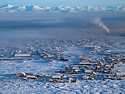 The Pole of Cold - Tomtor village seen from a nearby mountain. The area is extremely cold during the winter. Two towns by the highway, Tomtor and Oymyakon, both claim the coldest inhabited place on earth (often referred to as -71.2°C, but might be -67.7°C) outside of Antarctica. The average temperature in Oymyakon in January is -42°C (daily maximum) and -50°C (daily minimum). The images had been made during an outside temperature in between -50°C up to -55°C. Tomtor, Jakutien , Yakutia, Russian Federation, Russia, RUS, 19.01.2010