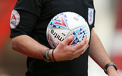 The referee holds the matchday ball