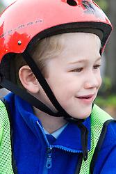 Boy wearing a cycle helmet,