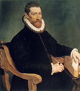 Portrait of a Man: oil on wood. Francis Pourbus the Elder (1545-1581) Flemish painter.  Seated man in fur trimmed velvet jacket holding a quill pen and a book.