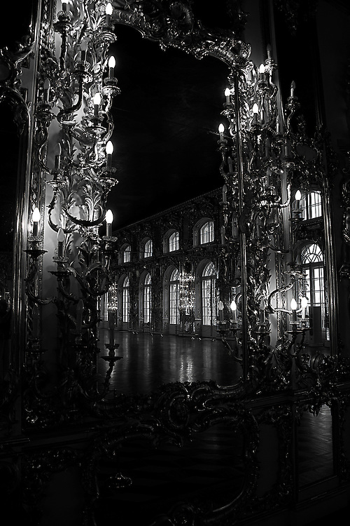 The Catherine Palace is a Rococo palace just southeast of St. Petersburg, Russia in the town of Tsarskoye Selo.  The ballroom where this photo was taken is lined with large windows and mirrors.