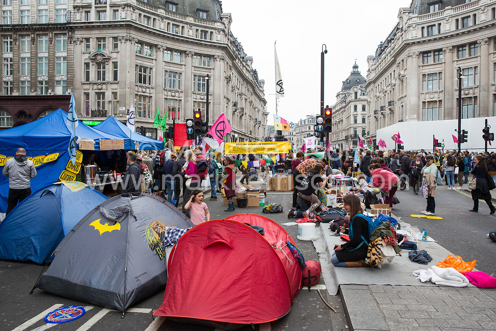 London, UK. 16th April 2019. Climate change activists from Extinction Rebellion occupy Oxford Circus on the second day of International Rebellion activities to call on the British government to take urgent action to combat climate change.
