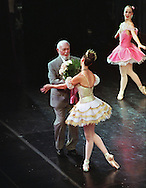 Fred Shadle, the elder statesman at age 83, historian and backstage manager for the Sacramento Ballet, presents a bouquet of roses to Kirsten Bloom, the lead female dancer at the end of the opening night performance of the Nutcracker at the Sacramento Community Center theatre, Thursday, December 6, 2000.  For 20 years Fred Shadle has volunteered his time to work backstage during the ballet season.