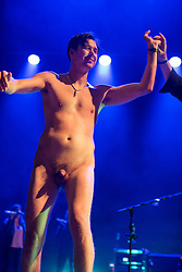 © Licensed to London News Pictures.  02/09/2017; Bristol, UK. WARNING, NUDITY: A male streaker invades the stage as ELBOW with singer Guy Garvey performs at The Downs Festival 2017 on The Downs in Bristol. Guy Garvey then took the streaker's hand and embraces the streaker. Picture credit : Simon Chapman/LNP