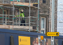A worker at the Balfour Beatty site on Laurieston Place. Edinburgh on the day after the Lockdown.