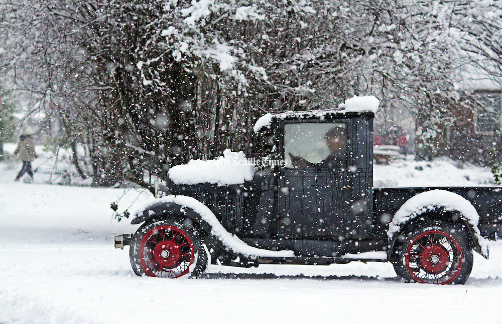 A motorist in a 1929 Model A drives to the post office through half a foot of snow that fell in Darrington. <br /> <br /> Mark Harrison / The Seattle Times