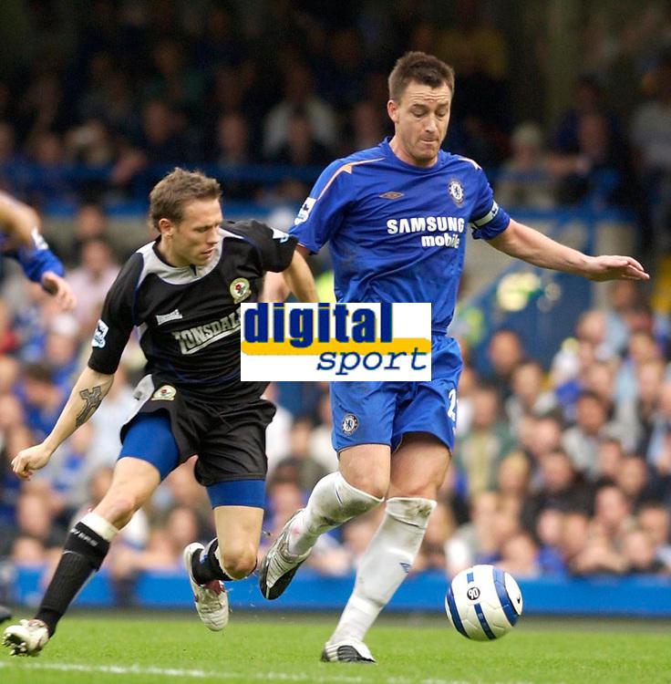 Photo: Daniel Hambury.<br />Chelsea v Blackburn Rovers. The Barclays Premiership.<br />29/10/2005.<br />Chelsea's John Terry holds off Blackburn's Craig Bellamy.