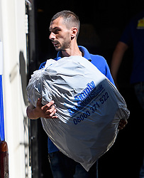 © Licensed to London News Pictures. 16/07/2016. London, UK. A bag being placed in a van marked for David Cameron. Removal men begin to take items from numbers 10 and 11 at Downing Street at the end of the week that saw Prime Minister David Cameron leave and Theresa May arrive. Photo credit: Ben Cawthra/LNP