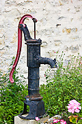 Old village water pump in Normandy, France