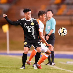 BRISBANE, AUSTRALIA - JANUARY 23: Jose Elmer Porteria of Ceres Negros and Dane Ingham of the Roar compete for the ball during the AFC Champions League Second Preliminary Round match between Brisbane Roar and Ceres Negros FC on January 23, 2017 in Brisbane, Australia. (Photo by Patrick Kearney)