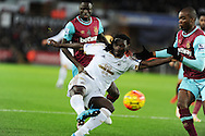 Bafetimbi Gomis of Swansea city has a shot at goal. Barclays Premier league match, Swansea city v West Ham Utd at the Liberty Stadium in Swansea, South Wales  on Sunday 20th December 2015.<br /> pic by  Andrew Orchard, Andrew Orchard sports photography.