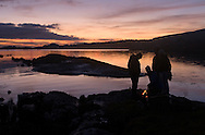 Revelers around a fire on the shore of Kenmare Bay, County Kerry, Ireland