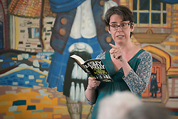 "A day of books in Portobello as part of the three-day long Portobello Book Festival. A series of packed events to hear a number of authors, some local, others from further afield talk about their writing. Pictured: Lesley Kelly reads from her thriller ""A Fine House in Trinity"".<br /> <br /> <br /> © Jon Davey/ EEm"