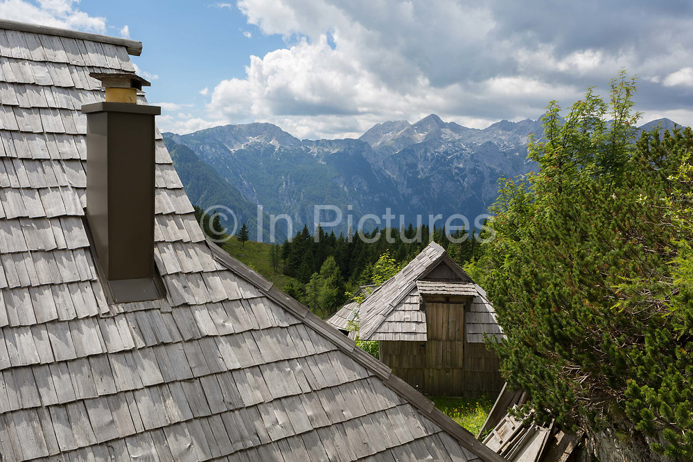 A Slovenian herders mountain holiday hut in Velika Planina, on 26th June 2018, in Velika Planina, near Kamnik, Slovenia. Velika Planina is a mountain plateau in the Kamnik–Savinja Alps - a 5.8 square kilometres area 1,500 metres 4,900 feet above sea level. Otherwise known as The Big Pasture Plateau, Velika Planina is a winter skiing destination and hiking route in summer. The herders huts became popular in the early 1930s as holiday cabins known as bajtarstvo but these were were destroyed by the Germans during WW2 and rebuilt right afterwards by Vlasto Kopac in the summer of 1945.