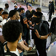 Protesters accuse another protester of being a police officer. Protests in Baltimore carry into the night, with many at City Hall. Protesters are out nationwide after the killing of George Floyd by Minneapolis police. The protests in Baltimore were mostly non violent with only the occasional pepper balls shot into the crowd to keep them off the barrier.
