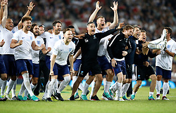 England players celebrate winning the UNICEF Soccer Aid match at Old Trafford, Manchester.