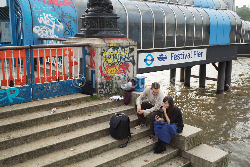 A quiet moment to sit, relax and chat for a while on the stone steps down to the River Thames on the Southbank. The South Bank is a significant arts and entertainment district, and home to an endless list of activities for Londoners, visitors and tourists alike.