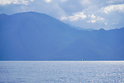Silhouetted landscape of Cephalonia Island, Greece as seen from the sea