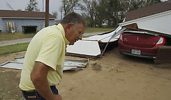 August 7, 2017 - Kiowa, KS, USA - Greg Miller looks over the remains of his garage and car Monday afternoon, Aug. 7, 2017 in Kiowa, Kan. Miller was parked in the drive in his truck ready to pull into the garage when the weather struck, blowing down the garage. (Credit Image: © Bo Rader/TNS via ZUMA Wire)