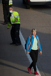 A first Insulate Britain climate activist walks into the clockwise carriageway of the M25 between Junctions 9 and 10 as part of a campaign intended to push the UK government to make significant legislative change to start lowering emissions on 21st September 2021 in Ockham, United Kingdom. Both carriageways were briefly blocked before being cleared by Surrey Police. The activists are demanding that the government immediately promises both to fully fund and ensure the insulation of all social housing in Britain by 2025 and to produce within four months a legally binding national plan to fully fund and ensure the full low-energy and low-carbon whole-house retrofit, with no externalised costs, of all homes in Britain by 2030.