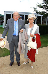 The DUKE & DUCHESS OF RICHMOND & GORDON at the 4th day of the 2005 Glorious Goodwood horseracing festival at Goodwood Racecourse, West Sussex on 29th July 2005.    <br />