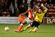 Sam Mantom fouls Romaine Sawyers during the Sky Bet League 1 match between Walsall and Sheffield Utd at the Banks's Stadium, Walsall, England on 17 March 2015. Photo by Alan Franklin.