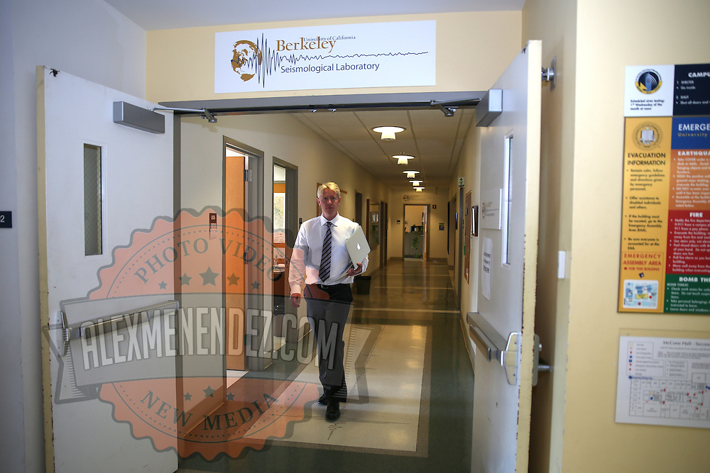 Richard M. Allen, Director of the Berkeley Seismological Laboratory walks through the hallway at his office in Berkeley, California, on Monday, August 24, 2014.  On Sunday, a 6.1 magnitude earthquake caused significant damage and left three critically injured in California's northern Bay Area early Sunday, igniting fires, sending at least 87 people to a hospital, knocking out power to tens of thousands and sending residents running out of their homes in the darkness. Aftershocks are still being captured across the area by seismometers that are recording seismic data. (AP Photo/Alex Menendez)