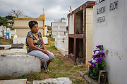 """2016/10/09 – Jama, Ecuador: Zoila Alciva, 78, visits her husband grave on the Jama cemetery, Ecuador., 9th October 2016. Her husband passed away after he was trapped between collapsing walls of their house during the 16th April earthquake. """"He was unable to escape because he was on a wheel chair"""" says Zoila. She is critic of the Government because she didn't got any help; all the help came from family and friends. (Eduardo Leal)"""