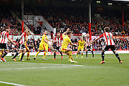 A dangerous corner kick makes its way through everyone to reach Brentford midfielder John Swift during the Sky Bet Championship match between Brentford and Rotherham United at Griffin Park, London, England on 17 October 2015. Photo by Andy Walter.